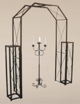 bronze candelabra with wedding arch