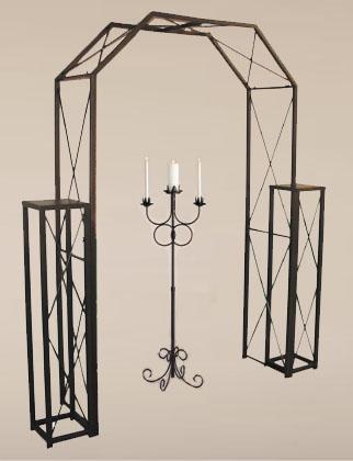 bronze candelabra with wedding arch